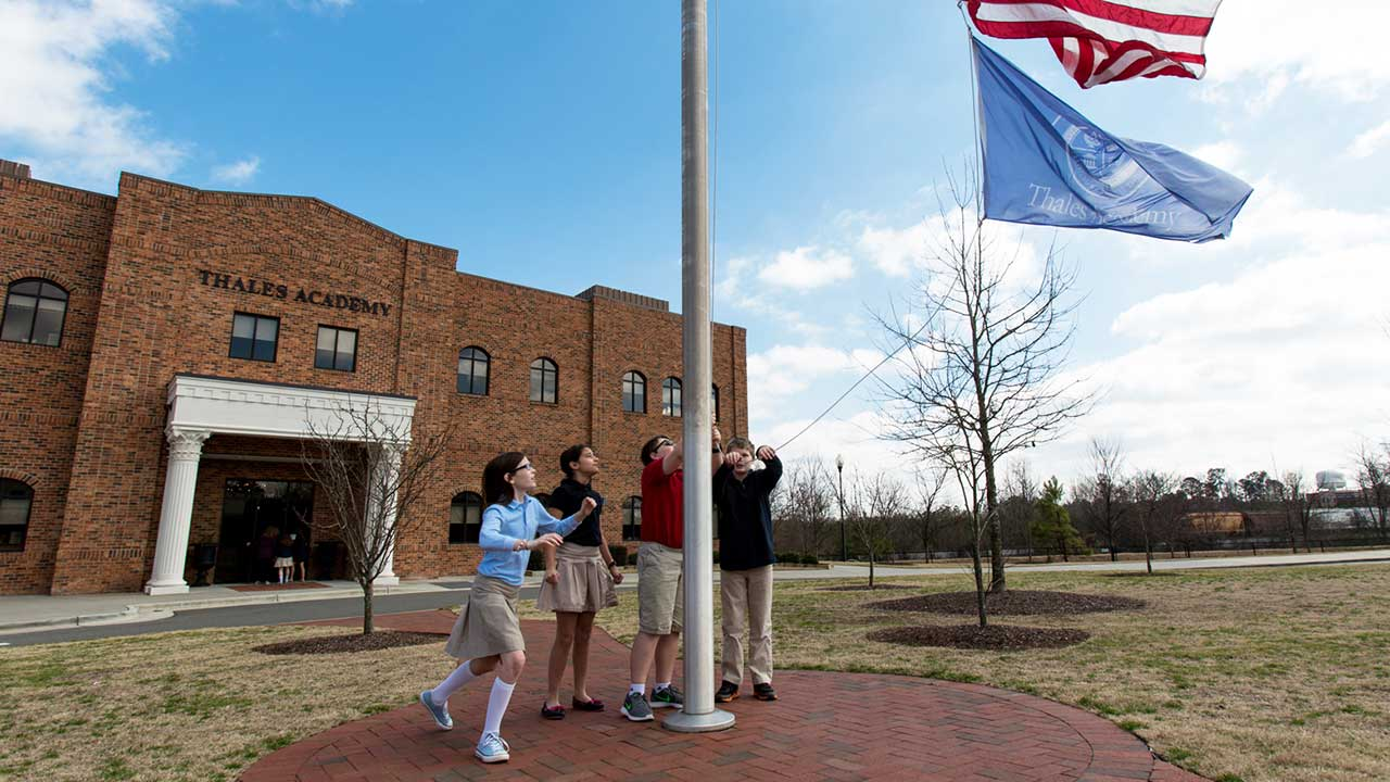 Thales Academy students raise American flag